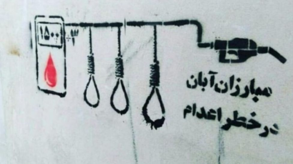 """Persian graffiti in Tehran saying: """"Our defenders are in danger of being executed"""""""