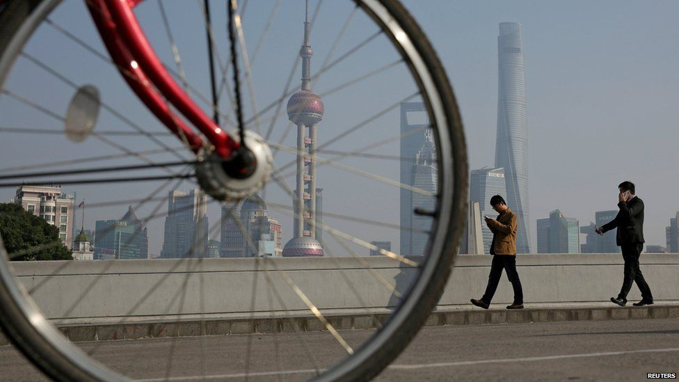 View of the Shanghai skyline with a bike in the foreground