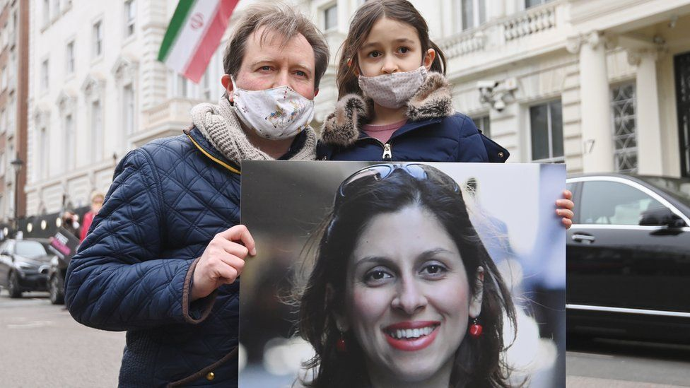 Richard Ratcliffe with his daughter Gabriella during a protest outside the Iranian Embassy in London, Britain