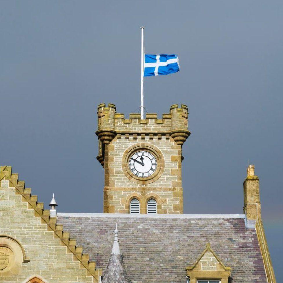 The Shetland flag flying at half mast above Lerwick's town hall.