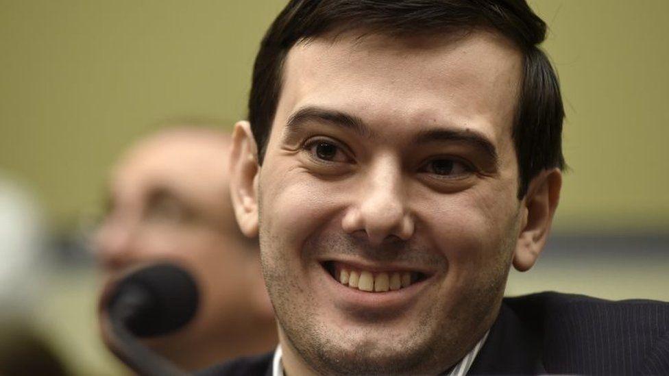 Pharmaceutical chief Martin Shkreli smiles on Capitol Hill in Washington.