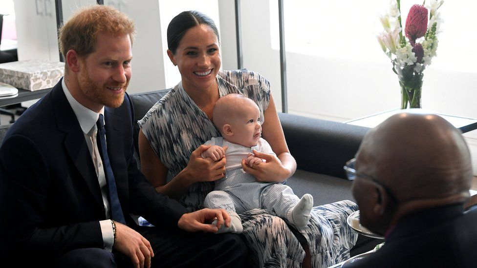 The Duke and Duchess of Sussex holding their son Archie as they meet Archbishop Desmond Tutu
