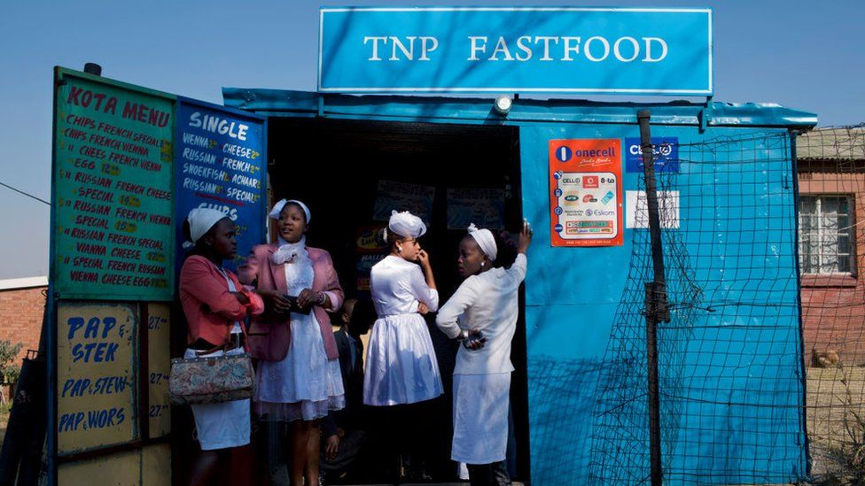Women queue for food in South Africa