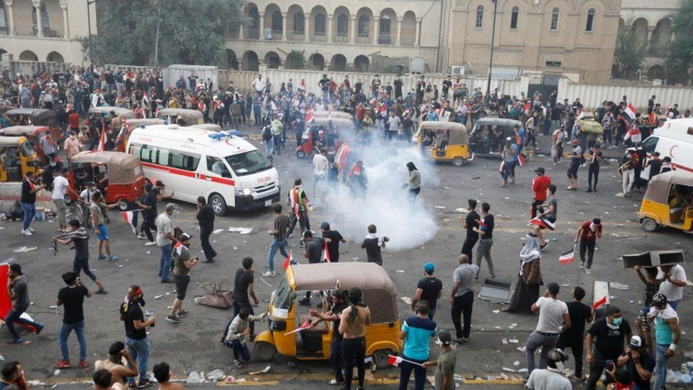 Demonstrators disperse as Iraqi security forces use tear gas in Baghdad