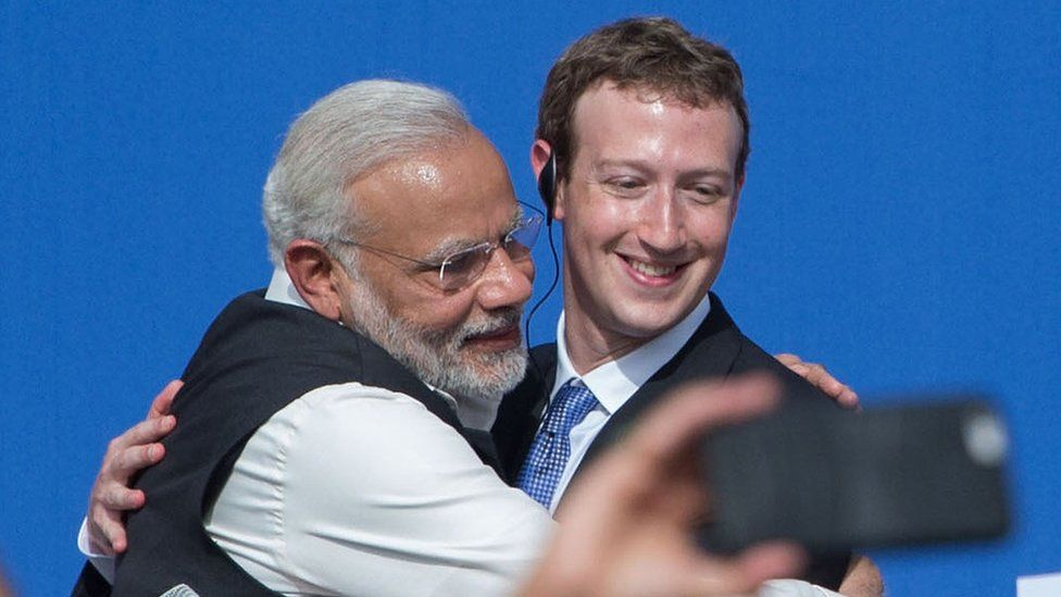 Indian Prime Minister Narendra Modi (left) and Facebook CEO Mark Zuckerberg (right) hug after the discussion