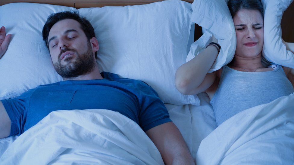 Woman unable to sleep due to man snoring
