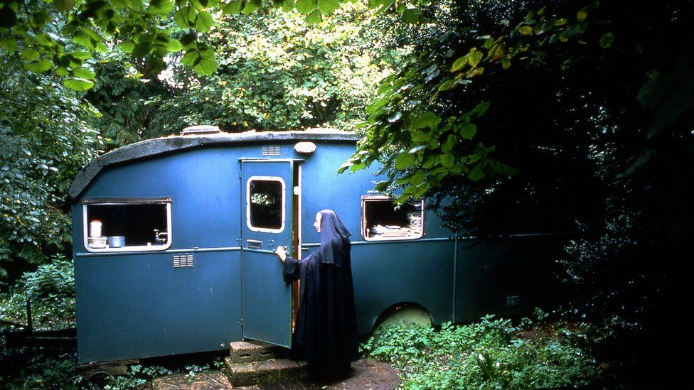 Sister Wendy Beckett at her hermitage - a caravan in the grounds of a Carmelite monastery at Quidenham in Norfolk.