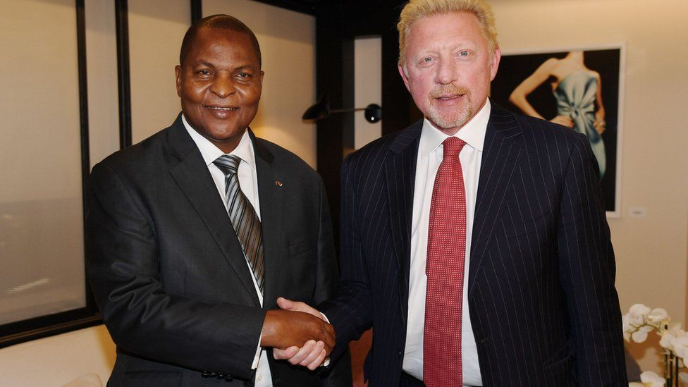Handout photograph released by Irle Moser Rechtsanwaite on June 19, 2018, shows the President of Central African Republic Faustin Archange Touadera (L) as he shakes hands with former German tennis player Boris Becker in Brussels on April 27, 2018
