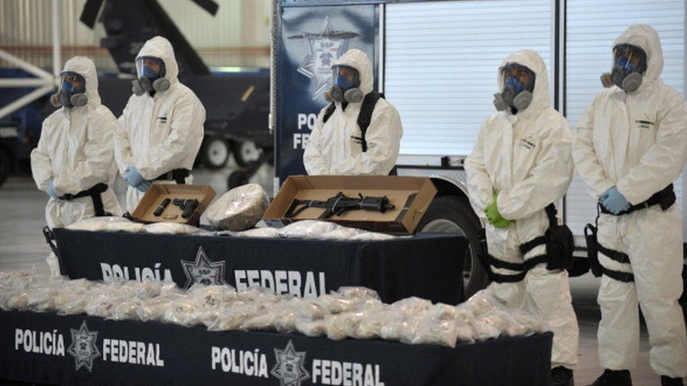 Mexican police display drugs and weapons seized from the Sinaloa cartel