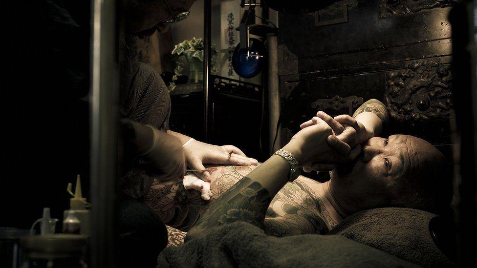 A man getting tattooed