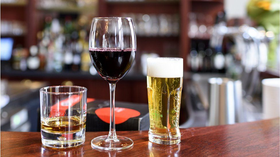 spirits, wine and beer on a bar