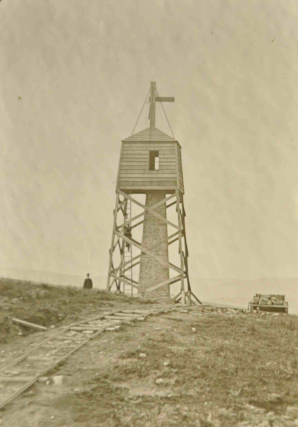 siteline worker showing one of many observatories which were constructed along the route of the aqueduct which were up to about 60ft high and were used by workers operating theodolite-like devices to measure and check the route of the aqueduct
