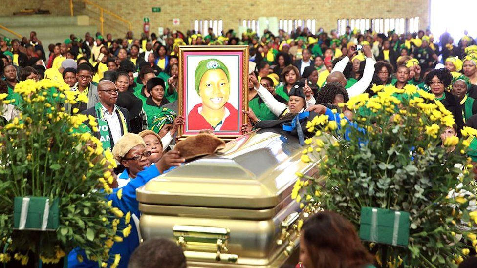 Relatives, party activists and representatives of the ANC Women's League gesture next to the coffin and the portrait of late African National Congress (ANC) ward candidate Khanyisile Ngobese-Sibisi,