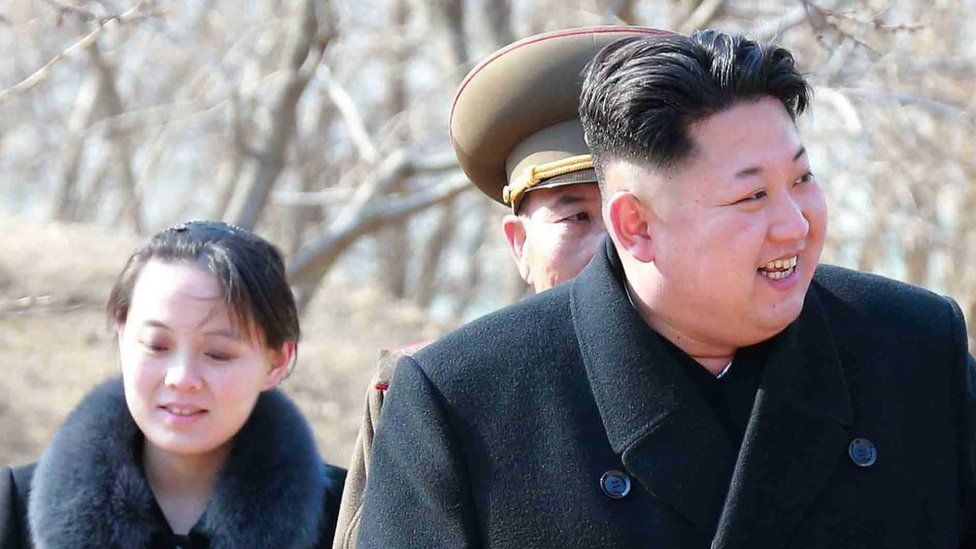 An undated picture released by the North Korean Central News Agency (KCNA) on 12 March 2015 shows North Korean leader Kim Jong-un (R) and Kim's younger sister Kim Yo-jong (L) touring a military unit on an island off the North Korean mainland near the sea border with South Korea in the East Sea