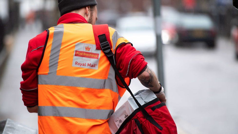 Postman with parcels