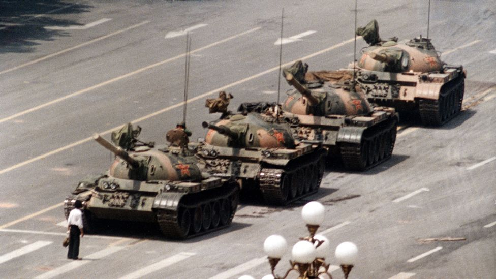 """June 5, 1989 file photo, a Chinese man stands alone to block a line of tanks heading east on Beijing""""s Cangan Blvd. in Tiananmen Square."""