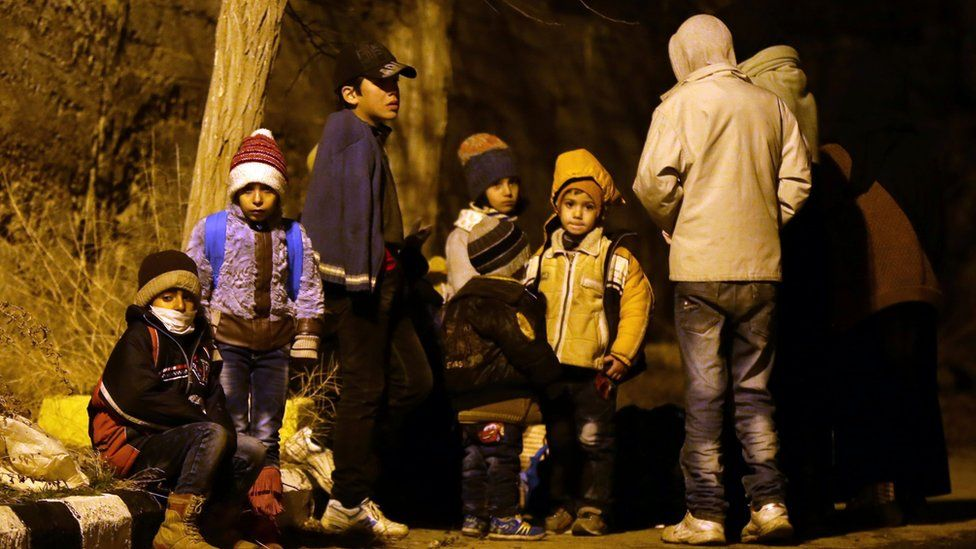 Syrian children waiting on the outskirts of the besieged rebel-held Syrian town of Madaya