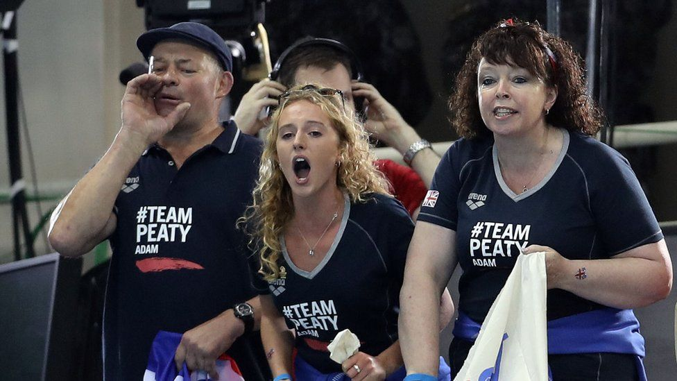 Mark and Caroline Peaty, with girlfriend Anna Zair, cheering on Adam Peaty's swim
