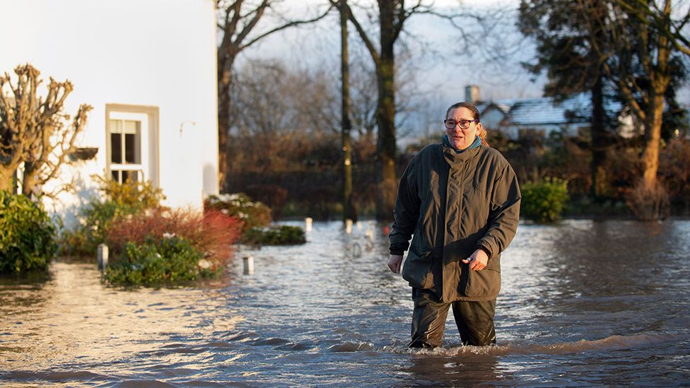 Gabrielle Burns-Smith outside her flooded home on the outskirts of Lymm in Cheshire as Storm Christoph causes widespread flooding across the UK