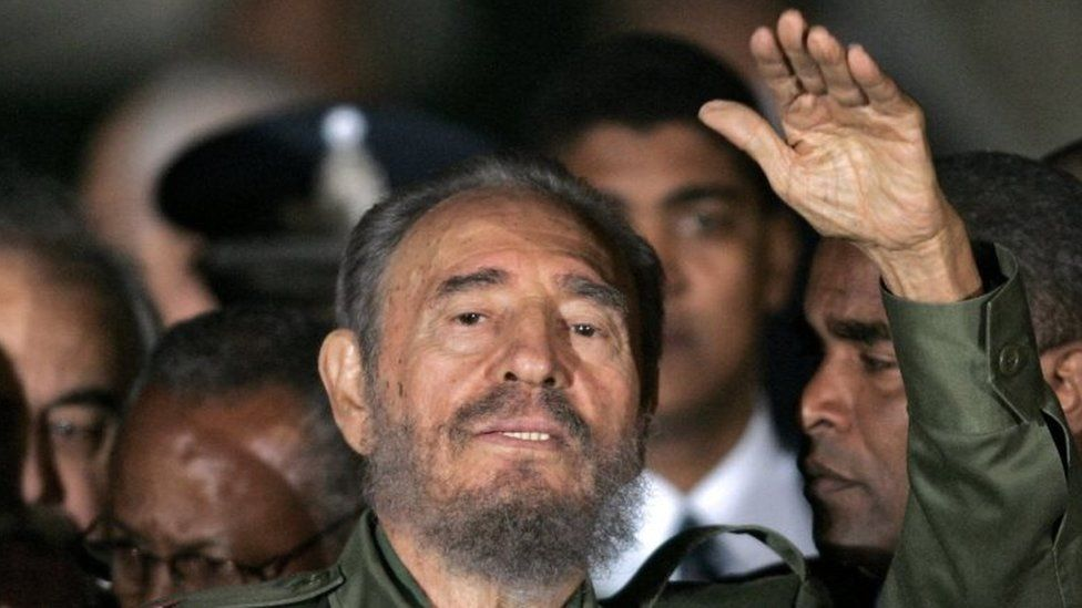 This file photo taken on July 21, 2006 shows President of Cuba Fidel Castro waving upon his arrival at Cordoba airport to participate to the Mercosur's presidential summit in Cordoba, Argentina. Cuban revolutionary icon Fidel Castro died late on November 25, 2016 in Havana, his brother, President Raul Castro, announced on national television