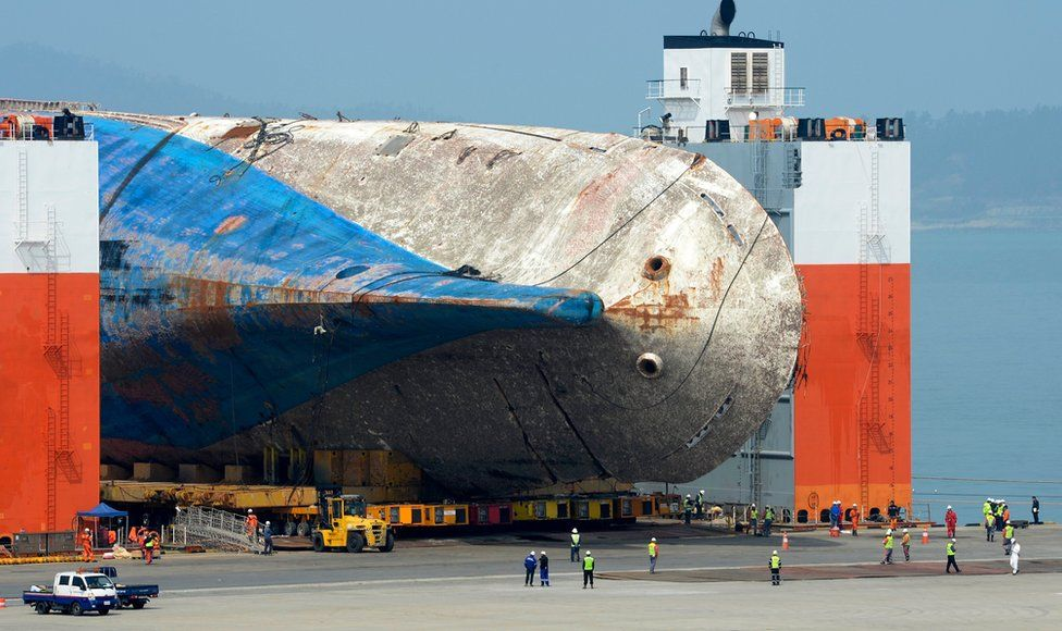 The salvaged Sewol ferry is moved onto land by module transporters to be put on a dry dock at a port in Mokpo, 410 km southwest of Seoul, South Korea, 9 April 2017