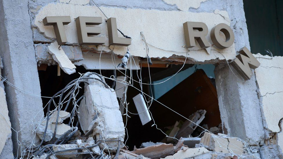 The damaged sign at the Hotel Rome, in Amatrice