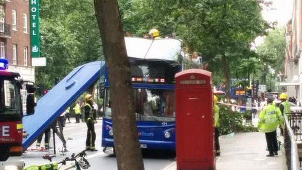 Damaged tour bus on Woburn Place, Bloomsbury
