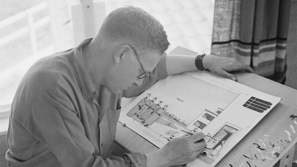 Carl Giles (1916 - 1995) at work in his studio on his farm in Suffolk, June 1948.
