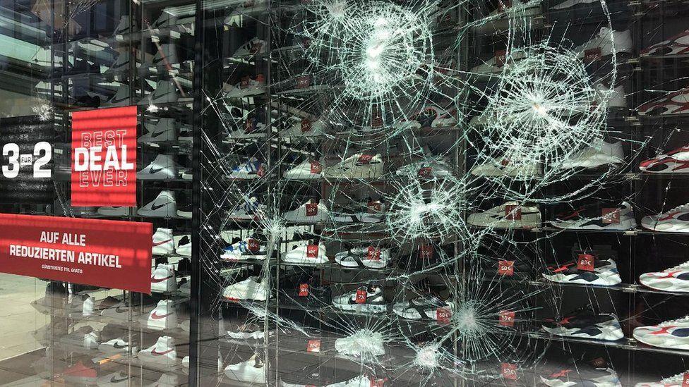 Smashed sports shop window in Stuttgart, 21 Jun 20