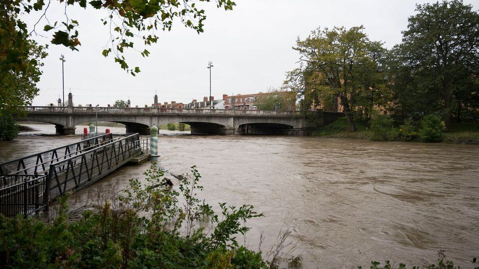 The River Taff flowing at a high level through Cardiff during Storm Callum