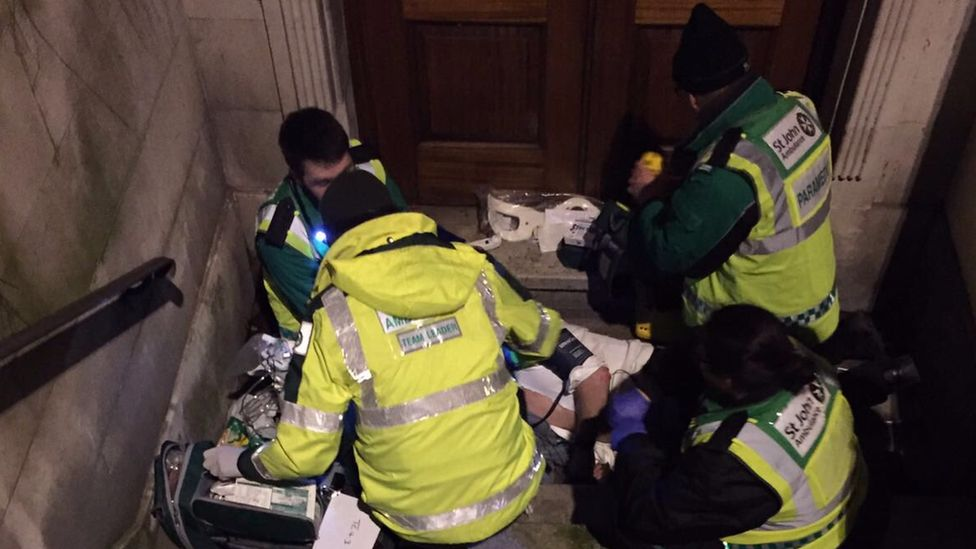 London Ambulance Service treating a patient
