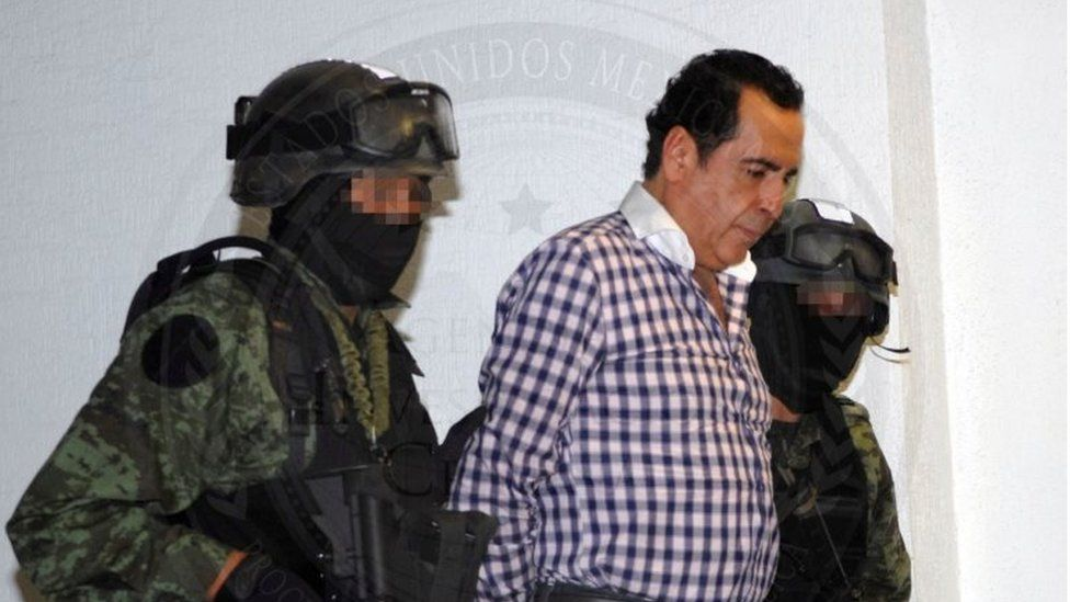 Soldiers escort head of the Beltran Leyva drug cartel Hector Beltran Leyva in Mexico City, in this handout picture taken October 1, 2014
