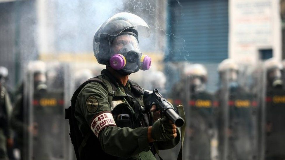 Members of the Bolivarian National Guard (GNB) block the passage to a demonstration against the government of President Nicolas Maduro in Caracas, Venezuela, 26 April 2017.