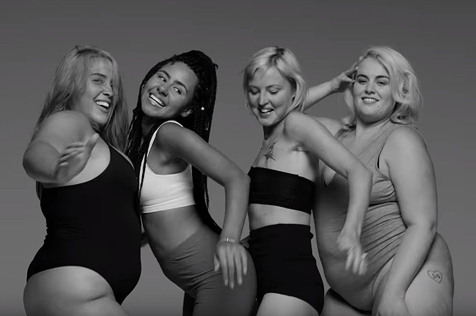 Kris Hallenga (second from right) in the Little Mix video for the song Strip
