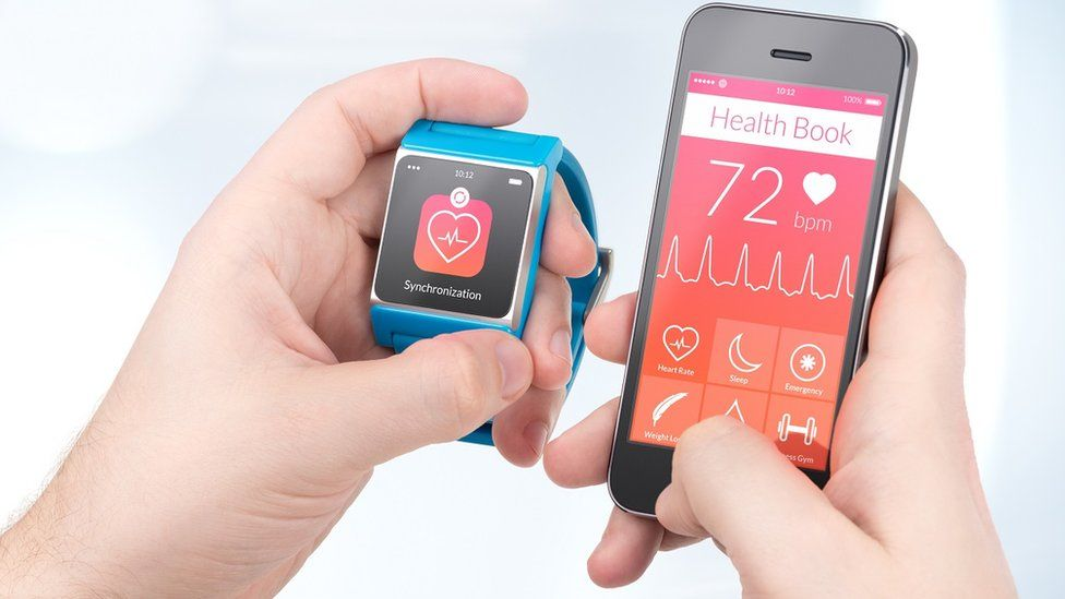 Smartphone and smartwatch showing heart monitor data