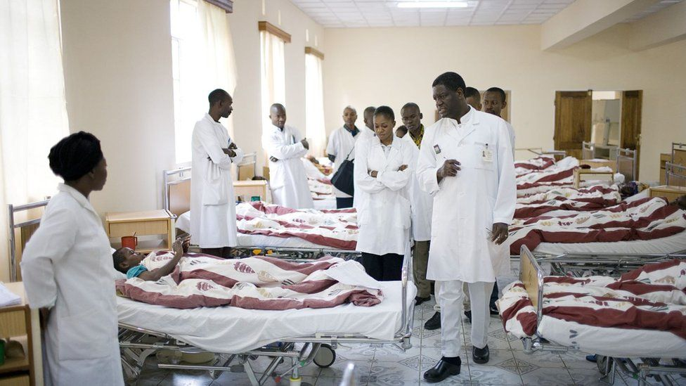 Dr. Denis Mukwege (c), a French trained gynecologist talks to staff and students during a round at the ward for recovering patients on November 2, 2007 in Bukavu, DRC.