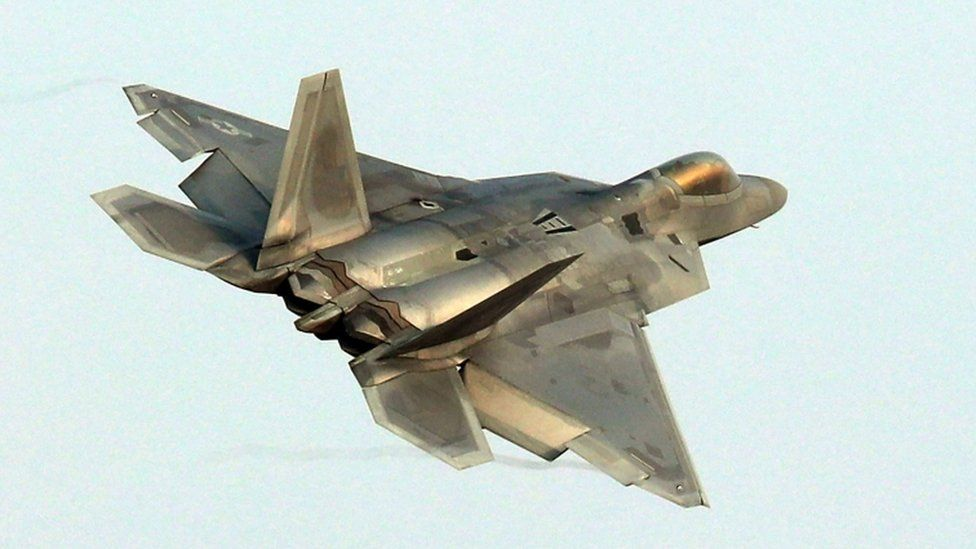 A US Air Force F-22 Raptor stealth jet flies over the air base at Gwangju as joint military exercises with South Korea get under way
