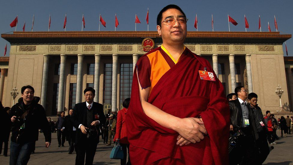 A living buddha of Tibet stands outside the Great Hall of the People in China's capital Beijing