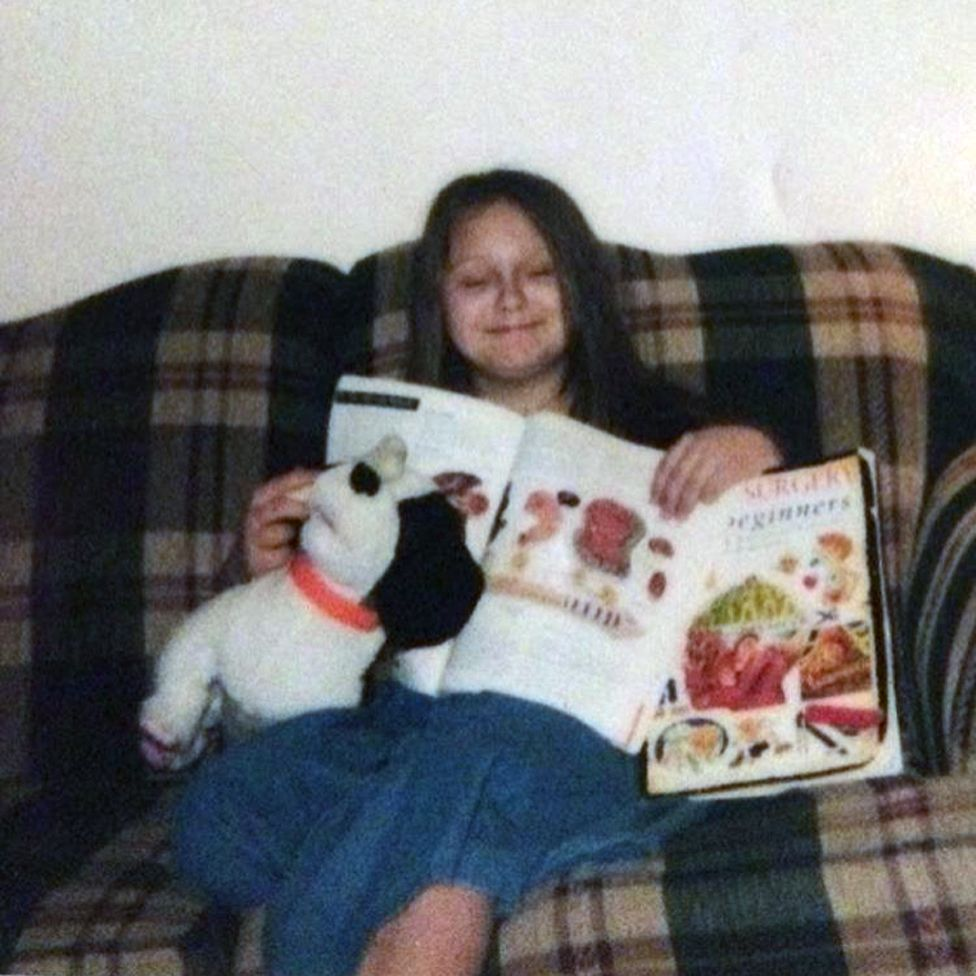 Rose Kalemba as a child, reading
