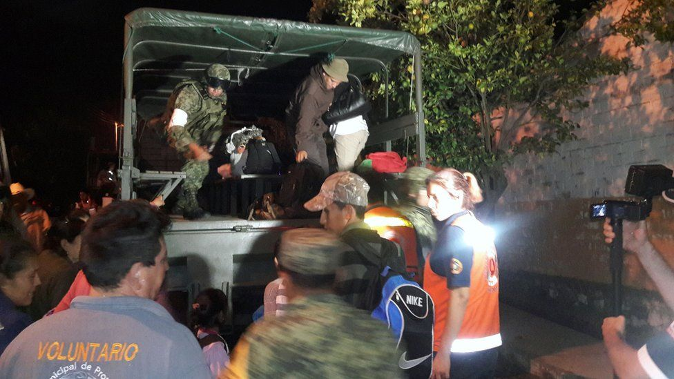Soldiers and volunteers help residents evacuate homes in Comala, Colima State, Mexico. 1 October 2016