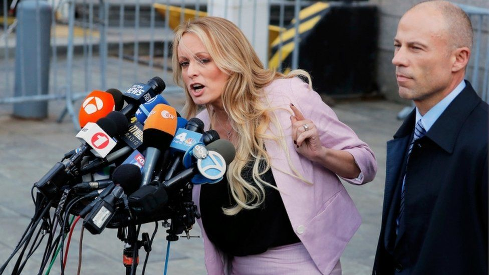 Stormy Daniels and Michael Cohen appear outside court