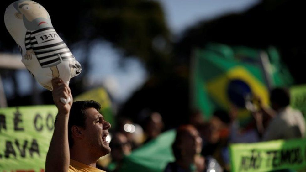People protest against former Brazilian President Luiz Inacio Lula da Silva, before a Brazilian court decides on an appeal by Lula da Silva against a corruption conviction that could bar him from running in the 2018 presidential race, in Brasilia, Brazil, January 23, 2018