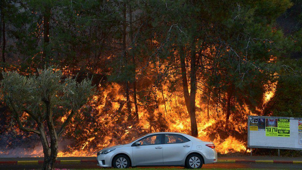 Car passing fire in Haifa
