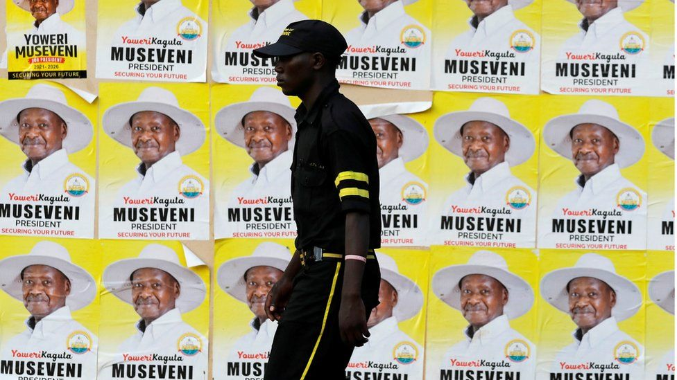 "A man walks past elections posters of Uganda""s President Yoweri Museveni on a street in Kampala, Uganda January 12, 2021."