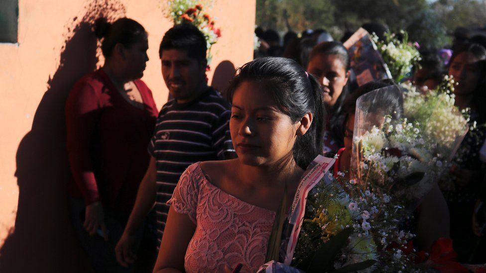 People take part in the funeral procession of Samir Flores Soberanes, 30, a Mexican activist