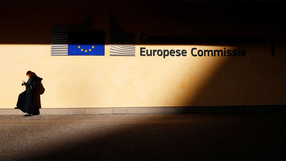 A woman is pictured outside the European Commission headquarters in Brussels