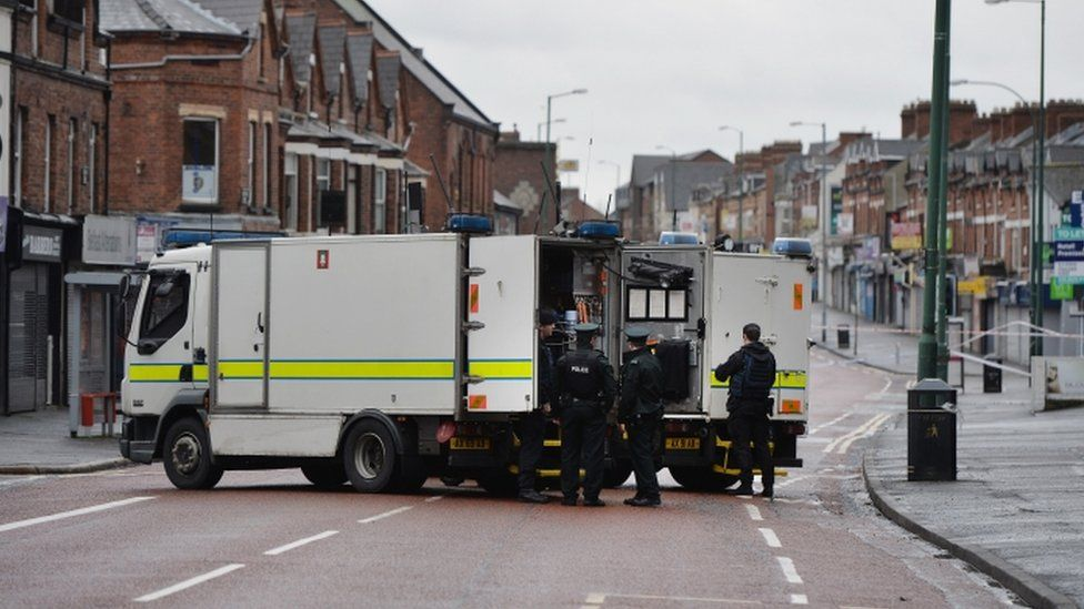 Police and bomb disposal officers at the scene of the bomb