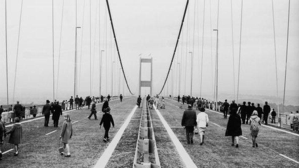 People walking along the Severn Bridge