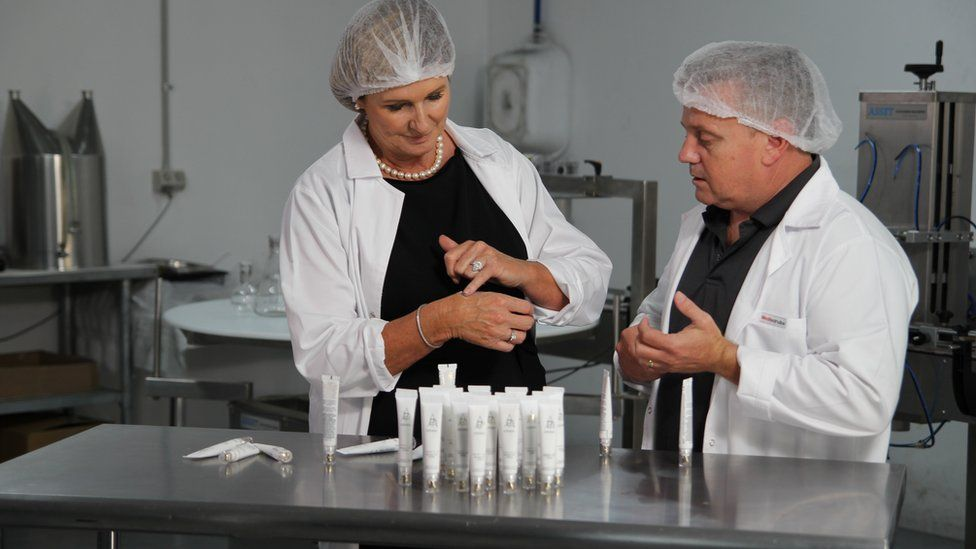 Michelle testing formulas with a colleague