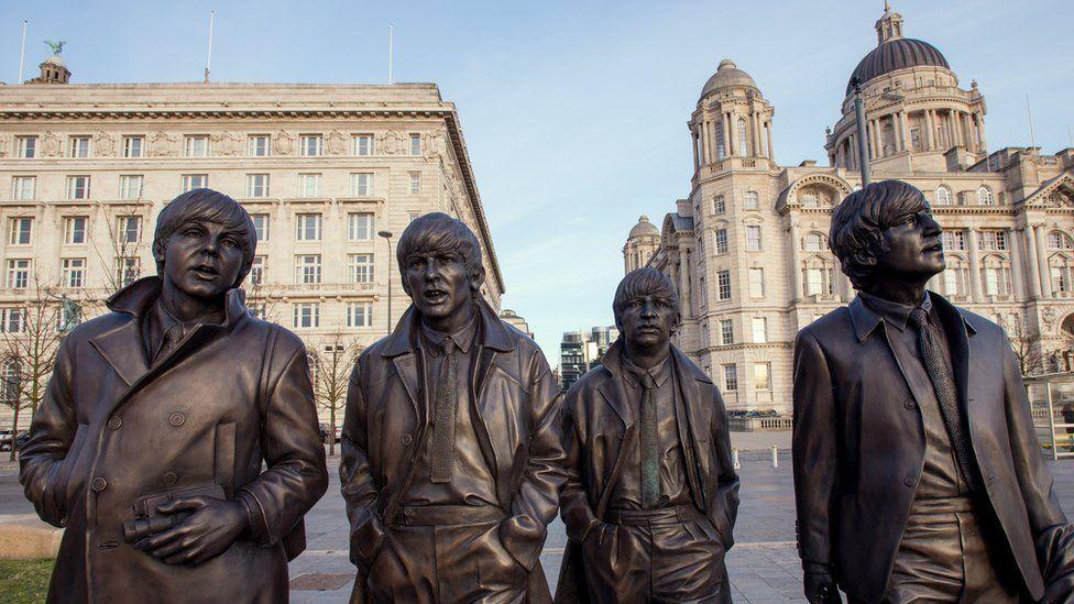 statue of Paul, George, Ringo and John
